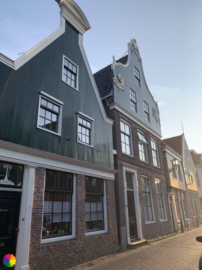 Facades of houses in De Rijp with a golden glow