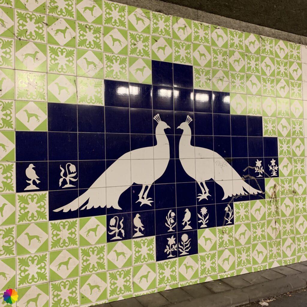 Tile tableau with peacocks